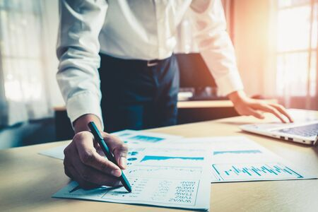 Photo for Businessman accountant or financial expert analyze business report graph and finance chart at corporate office. Concept of finance economy, banking business and stock market research. - Royalty Free Image