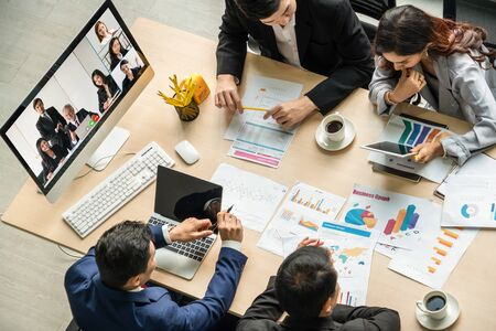 Foto de Video call group business people meeting on virtual workplace or remote office. Telework conference call using smart video technology to communicate colleague in professional corporate business. - Imagen libre de derechos