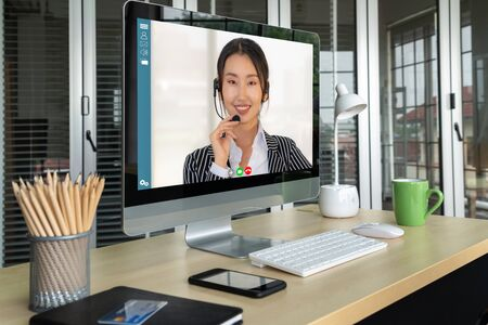 Photo pour Video call business people meeting on virtual workplace or remote office. Telework conference call using smart video technology to communicate colleague in professional corporate business. - image libre de droit