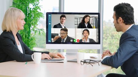 Photo pour Video call group business people meeting on virtual workplace or remote office. Telework conference call using smart video technology to communicate colleague in professional corporate business. - image libre de droit