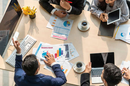 Photo for Business people group meeting shot from top view in office . Profession businesswomen, businessmen and office workers working in team conference with project planning document on meeting table . - Royalty Free Image