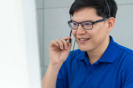 Photo pour Business people wearing headset working in office to support remote customer or colleague. Call center, telemarketing, customer support agent provide service on telephone video conference call. - image libre de droit