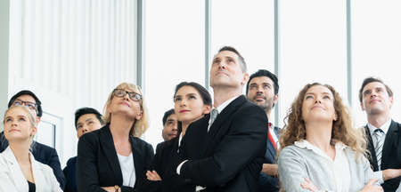 Photo pour Successful business people standing together showing strong relationship of worker community. A team of businessman and businesswoman expressing a strong group teamwork at the modern office. - image libre de droit