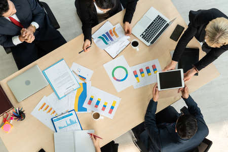 Photo pour Business people group meeting shot from top view in office . Profession businesswomen, businessmen and office workers working in team conference with project planning document on meeting table . - image libre de droit