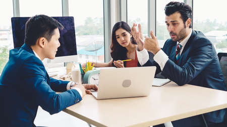 Photo pour Smart businessman and businesswoman talking discussion in group meeting at office table in a modern office interior. Business collaboration strategic planning and brainstorming of coworkers. - image libre de droit