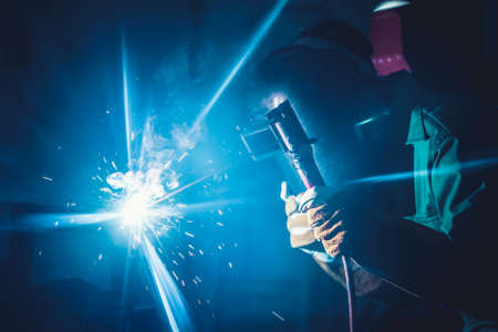 Photo pour Metal welding steel works using electric arc welding machine to weld steel at factory. Metalwork manufacturing and construction maintenance service by manual skill labor concept. - image libre de droit
