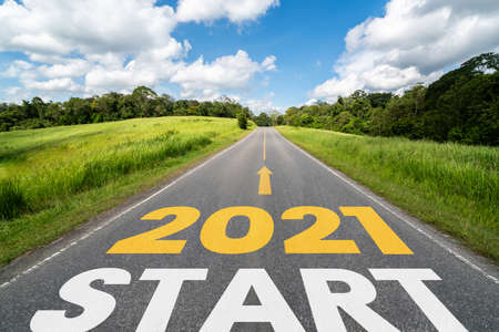 Photo for 2021 New Year road trip travel and future vision concept . Nature landscape with highway road leading forward to happy new year celebration in the beginning of 2021 for fresh and successful start . - Royalty Free Image