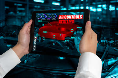 Photo pour Engineer use augmented reality software to monitor parts of car vehicle with automated application . Futuristic machinery in working in concept of Industry 4.0 or 4th industrial revolution. - image libre de droit