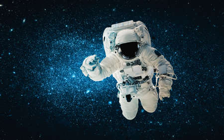 Foto de Astronaut spaceman do spacewalk while working for space station in outer space . Astronaut wear full spacesuit for space operation . - Imagen libre de derechos