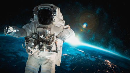 Foto de Astronaut spaceman do spacewalk while working for space station in outer space . Astronaut wear full spacesuit for space operation - Imagen libre de derechos