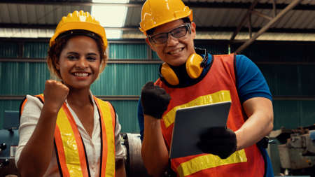 Photo pour Two skillful factory engineer or worker happy portrait looking at camera . Industrial people and manufacturing labor concept . - image libre de droit