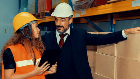 Photo for Warehouse senior manager discuss with worker in the storehouse . Logistics , supply chain and warehouse business concept . - Royalty Free Image