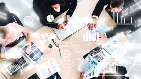 Photo pour Creative visual of business people in corporate staff meeting . Concept of digital technology for marketing data analysis and investment decision making . - image libre de droit