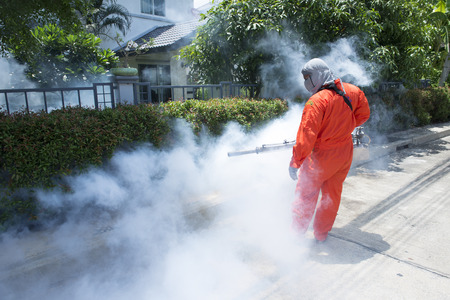 Photo for Workers are fogging for dengue control. - Royalty Free Image