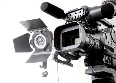 isolated digital video camera recorder on tripod  and spot light with white background