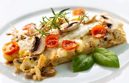 Tasty healthy fish fillet with vegetables and mushrooms