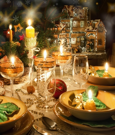Christmas dinner table with candles with christmas atmosphere