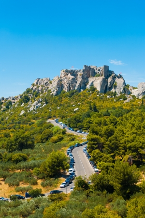 Ruins of the town of Les Baux de Provence sit atop a rocky outcrop in beautiful Provence, France.  Vertical