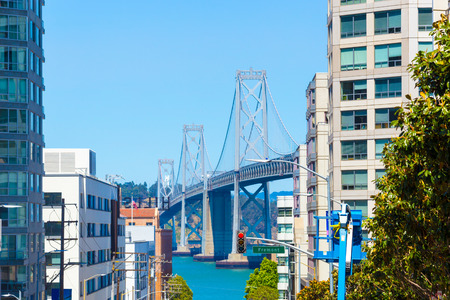 Telephoto view down Harrison Street of Bay Bridge towers and residential apartement buildings thru to Treasure Island on sunny summer day in San Francisco, California. Horizontal