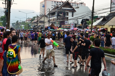 CHIANG MAI, THAILAND - APRIL 13 : People celebrating Songkran (Thai new year / water festival) in the streets by throwing water at each other on 13 April 2013 in Chiang Mai, Thailand