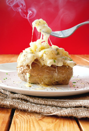 Hot baked jacket potato with melting cheese