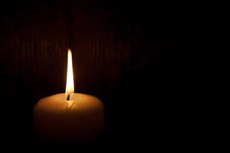 Single lit candle