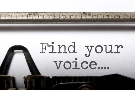 Photo pour Find your voice printed on an old fashioned typewriter - image libre de droit