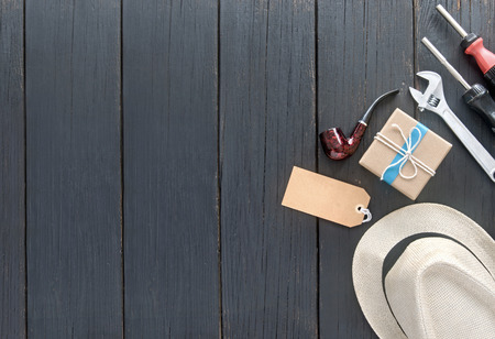 Photo pour Fathers day gift box tied in blue ribbon over a wooden background with label - image libre de droit