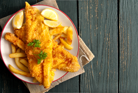 Photo for Close up of battered fish on a plate with chips - Royalty Free Image