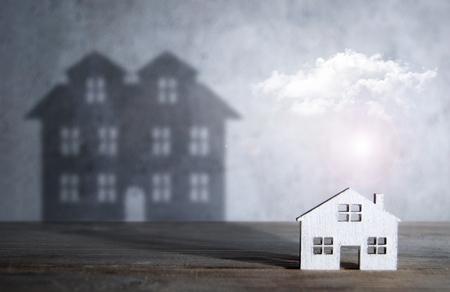 Foto de Shadow of a large house from a miniature home - Imagen libre de derechos