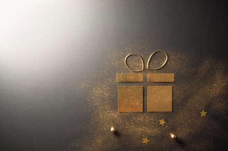 Foto de Gift box icon created with card and gold glitter - Imagen libre de derechos