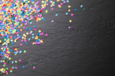 Foto de colorful confetti blackboard background - Imagen libre de derechos