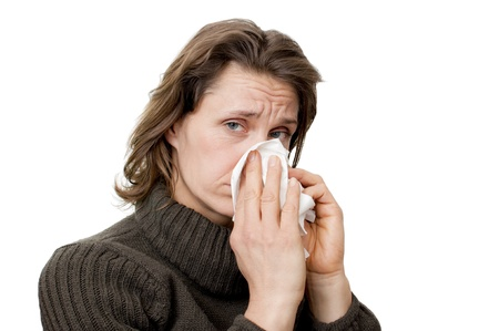 woman having a cold blowing her nose