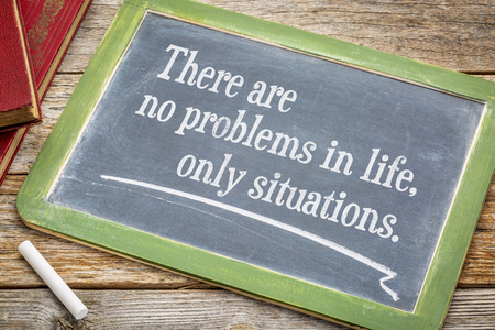 Foto de There are no problems in life, only situations - white chalk text  on a slate blackboard. - Imagen libre de derechos