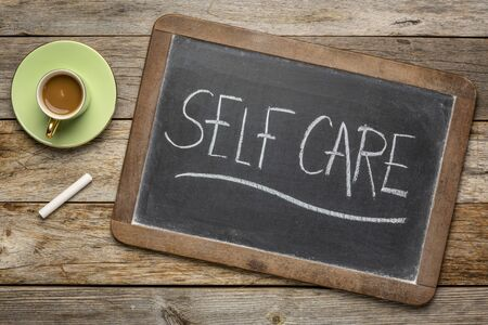 Photo for Self care - white chalk handwriting on a blackboard with a cup of coffee, lifestyle and healthcare concept - Royalty Free Image