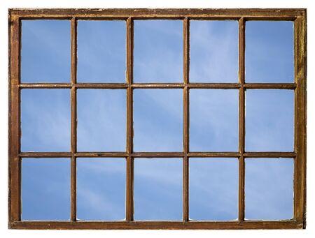 Photo pour blue sky with delicate white clouds as seen from a vintage sash window - image libre de droit
