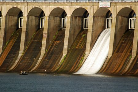 Water rushes through one of the flood gates at Wilson Dam in Muscle Shoals, Alabama generating electricity in North West Alabama.
