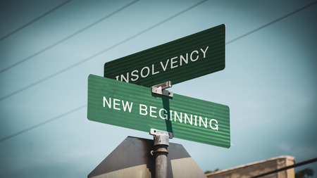 Photo pour Street Sign the Direction Way to NEW BEGINNING versus INSOLVENCY - image libre de droit