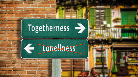 Photo pour Street Sign the Direction Way to Togetherness versus Loneliness - image libre de droit