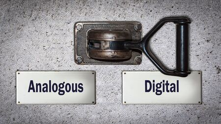 Photo for Wall Switch the Direction Way to Digital versus Analogous - Royalty Free Image