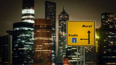 Street Sign the Direction Way to Morality versus Profit