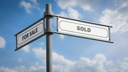Photo pour Street Sign the Direction Way to SOLD versus FOR SALE - image libre de droit