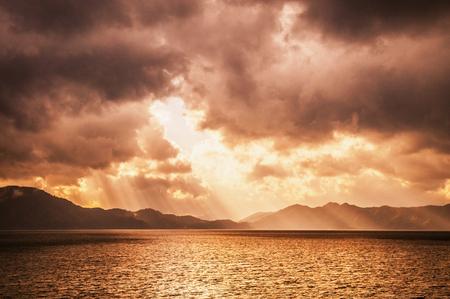 Sunset sky before storm with divine ligth at lake Tazawa, Semboku, Akita, Japan.