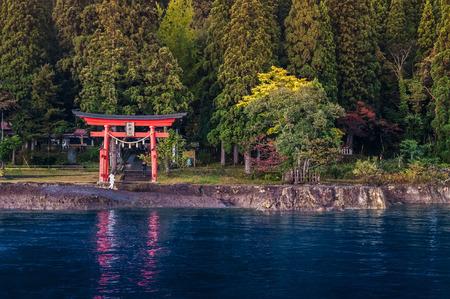 Red Torii of Shrine at Lake Tazawa ko, Senboku, Akita, Japan.