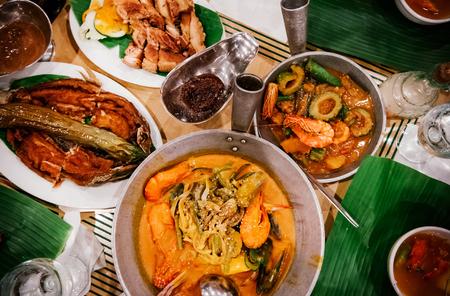 Foto de Meal set of various traditional Filippino Food,  Pakbet, lechon kawali, Bale Dutung. Top view - Imagen libre de derechos