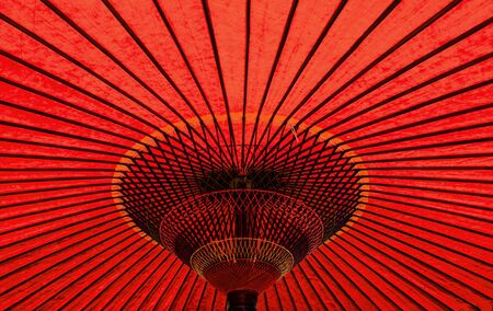 Photo for Vibrant red colour vintage retro traditional Japanese or asian paper cotton parasol umbrella background - Royalty Free Image