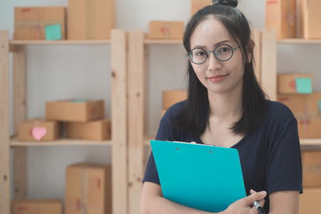 Photo pour Young Asian Woman Working at home, Young business start up online seller owner,  Delivery Project, Woman with Online Business or SME Concept. - image libre de droit