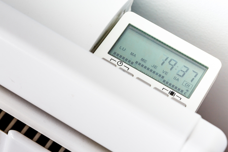 High angle closeup of modern radiator with digital timer