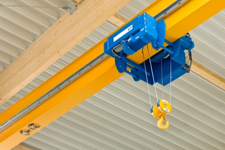 Photo for Overhead travelling crane in a production hall - Royalty Free Image