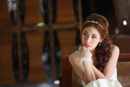Young Asian lady in white bride dress